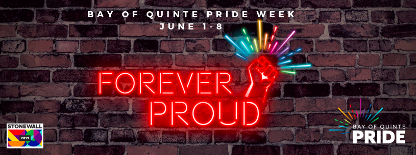 brick wall with text reading Bay of Quinte Pride Week - Forever Proud'