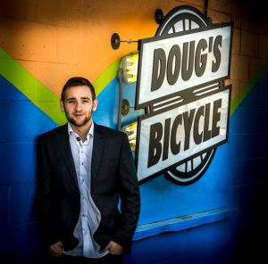 Tyler standing in front of Dougs Bicycle