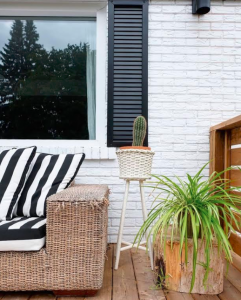 Indoor plants on a deck to add colour to an outdoor living space.