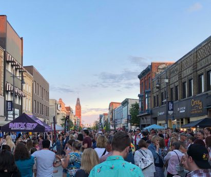 Crowd of people standing in the streets of downtown Belleville, Bay of Quinte