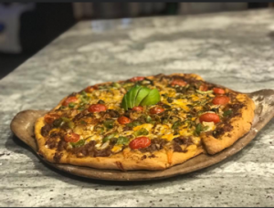 A pizza on a counter top.