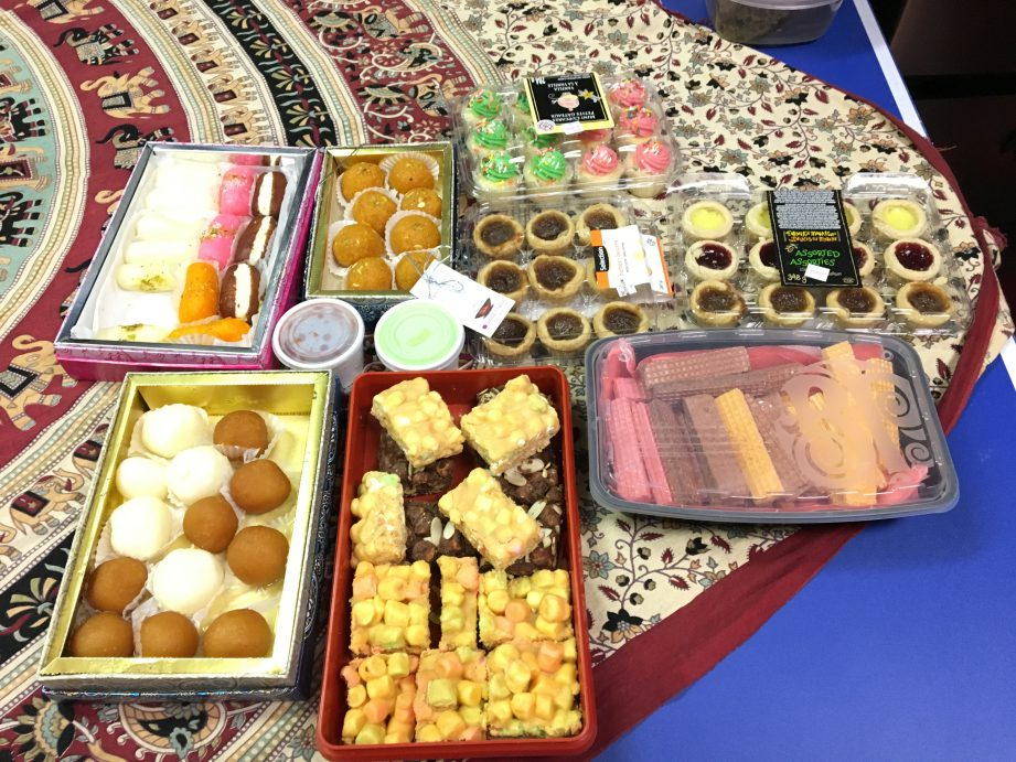 Trays of desserts on a table.