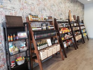 Shelves full of sauces and products