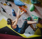 Female rock climbing indoors