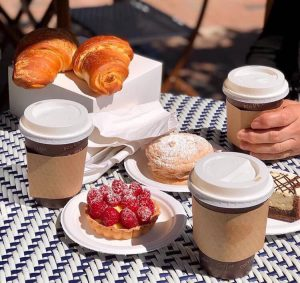 Coffee and French pastry on table