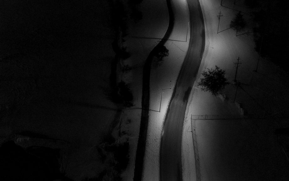 Aerial black-and-white photo of two trails.
