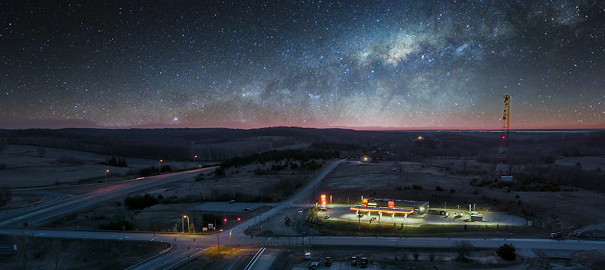 Aerial photo of highway roads and construction with a starry night.