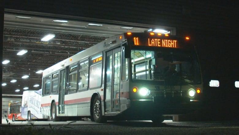 A Belleville city transit bus at night.