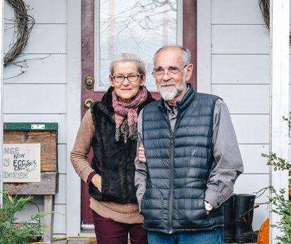 Audrey and James Potts, owners of Palliser Downs Farms in Quinte West, standing side by side on their front porch.
