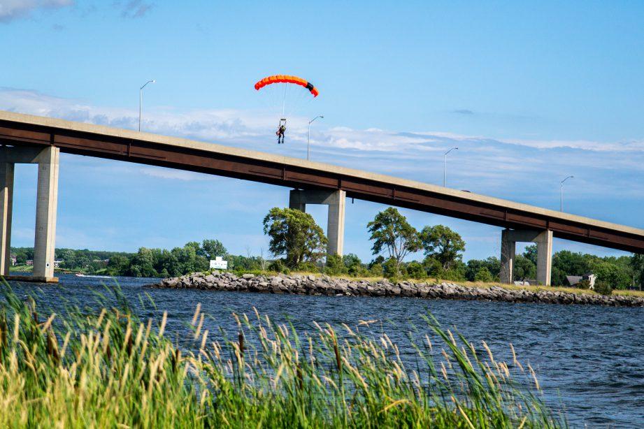 A parasailer drops above the Bay of Quinte