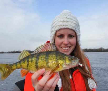 Ashley Rae holds a perch on the Bay of Quinte