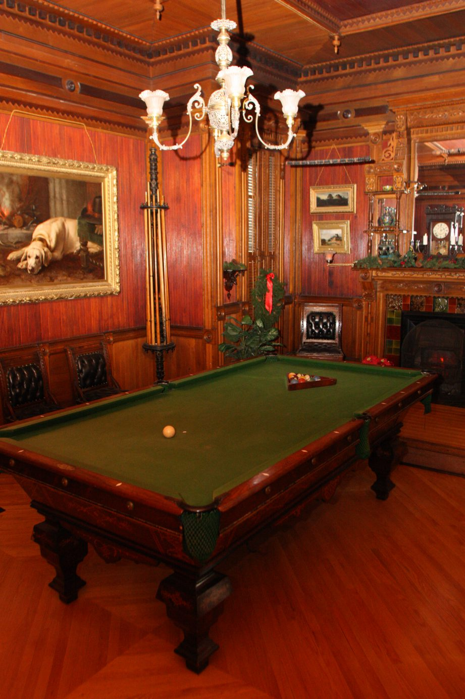 A photo of the billiards table in the site's wood panelled games room.