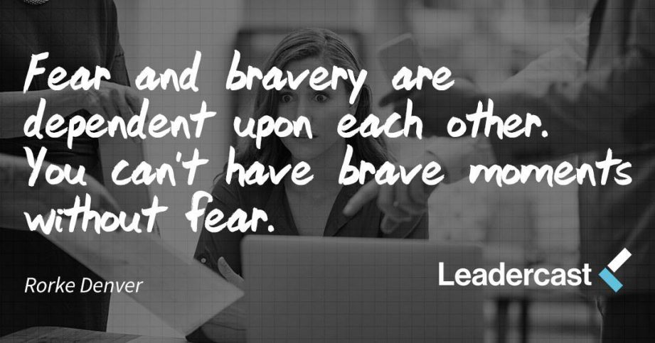 "Grey background with a picture of an office employee looking fearful as coworkers point at a sheet of paper. White cursive writing that quotes Rorke Denver saying ""Fear and bravery are dependent upon each other. You can't have brave moments without fear."" For Leadercast come to Quinte West."