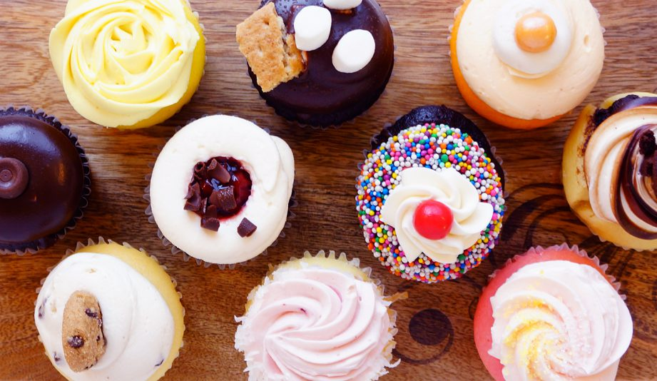 Photo of an assortment of colourful cupcakes