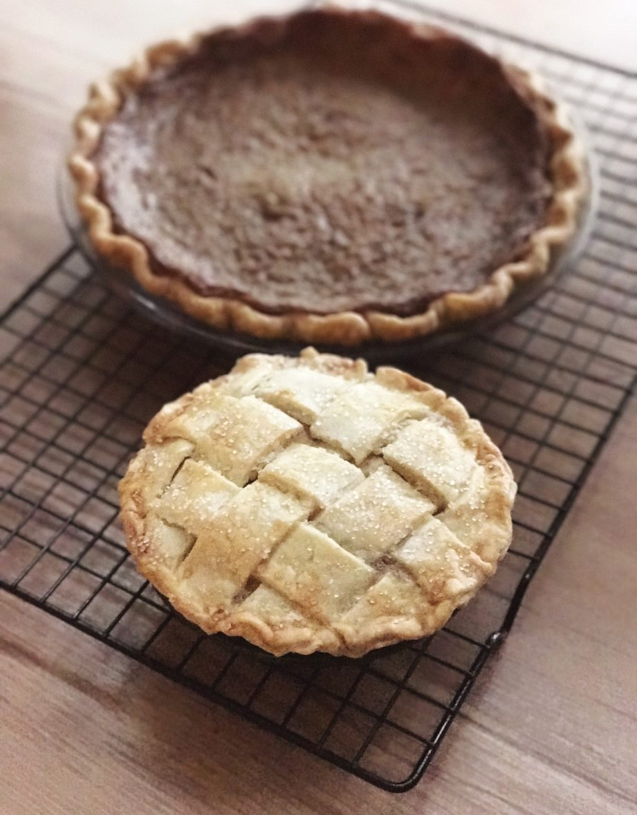 Photo of a hand made pumpkin pie and weaved top mini apple pie