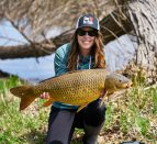 Ashley Rae holding a carp she caught during some spring fishing.