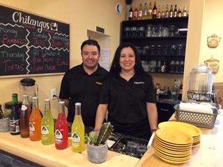 Abraham and Marlem Ramos behind the counter at Chilangos Restaurant.