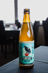 A bottle of Empire Cider on the table at the Whistling Duck Restaurant.