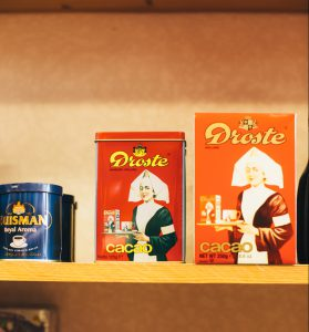 Boxes of dutch cocoa on the shelf at Trenton Delicatessen.