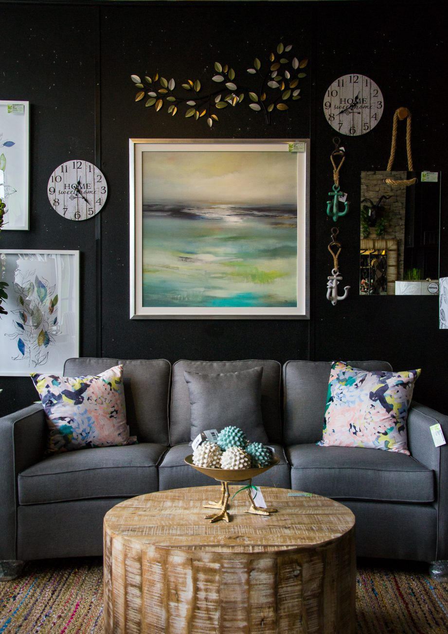 An interior design display with a couch, coffee table and wall art at Wish Home Accents in downtown Trenton.