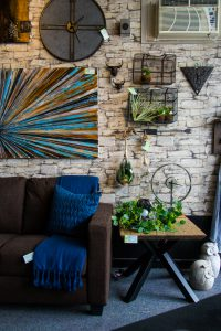 A couch and wall display at Wish Home Accents.