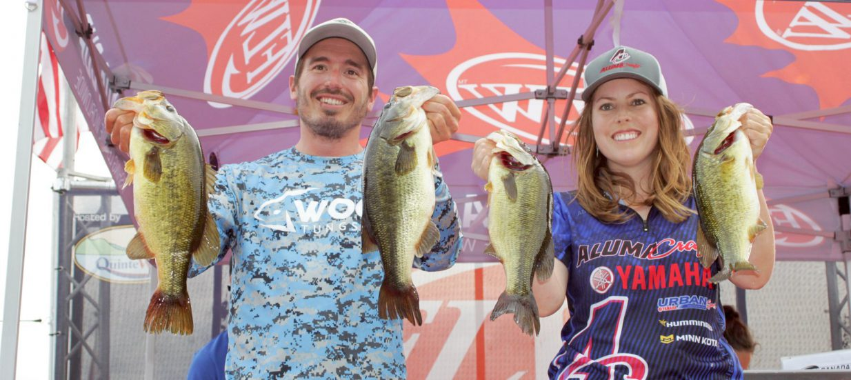 Ashley Rae and Erik Luzak hold their fish at the weigh-in station at the FLW Canada Cup in 2018.