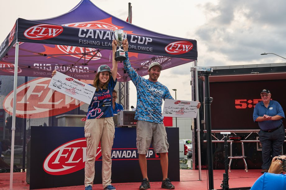 Ashley Rae and Erik Luzak hold up their hands in victory after winning the FLW Canada Cup.