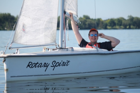 Michael on a boat at Quinte SailAbility.