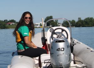 An instructor sitting on a boat at Quinte SailAbility.