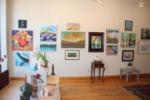 A wall of paintings at the Quinte Arts Council, part of the Belleville Gallery District.