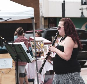 A woman playing a clarinet.