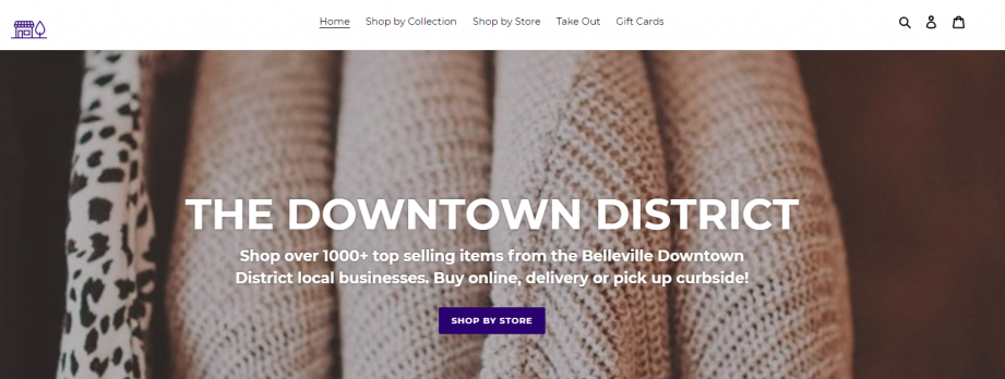 A screenshot of a webpage with clothes in the background and text that says 'The Downtown District'