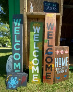 Hand-painted signs that say 'Welcome'