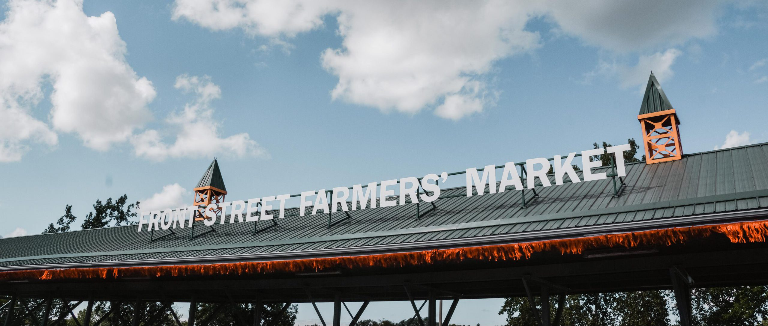 A sign for the Front Street Farmers' Market