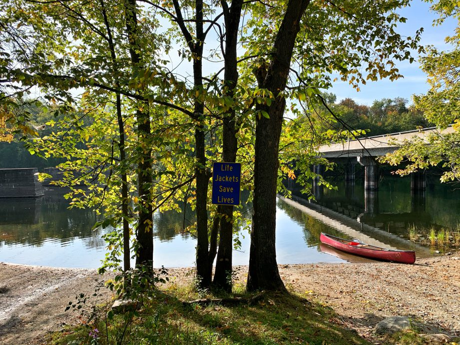A hammock hanging between trees beside a river. A house with a canoe on top, in front of a red-brick house. Find out what it's like heading out for a fall paddling adventure on the Might Moira River north of Belleville!