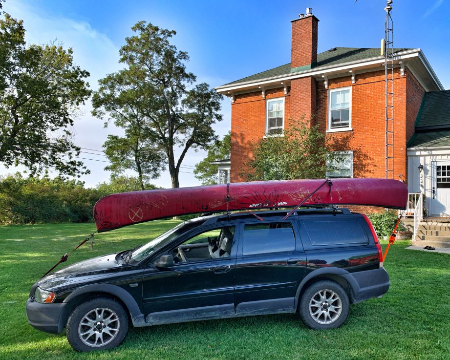 A house with a canoe on top, in front of a red-brick house. Find out what it's like heading out for a fall paddling adventure on the Might Moira River north of Belleville!