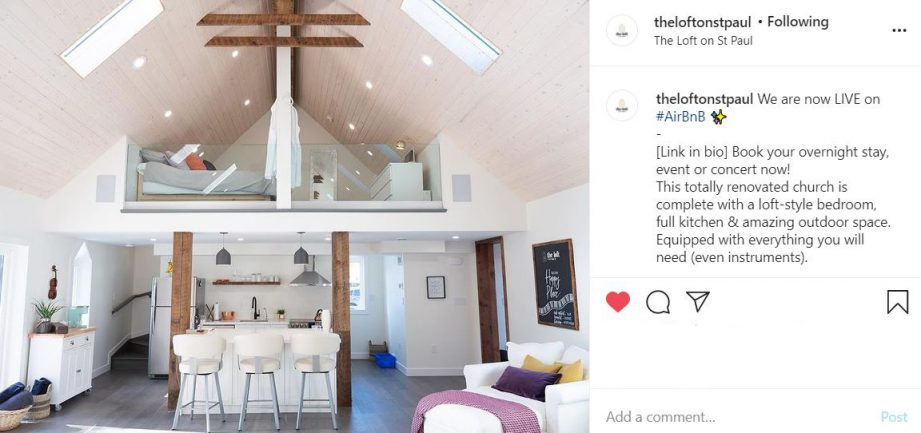 A screenshot of an Instagram photo. A white-painted loft decorated with modern furniture.