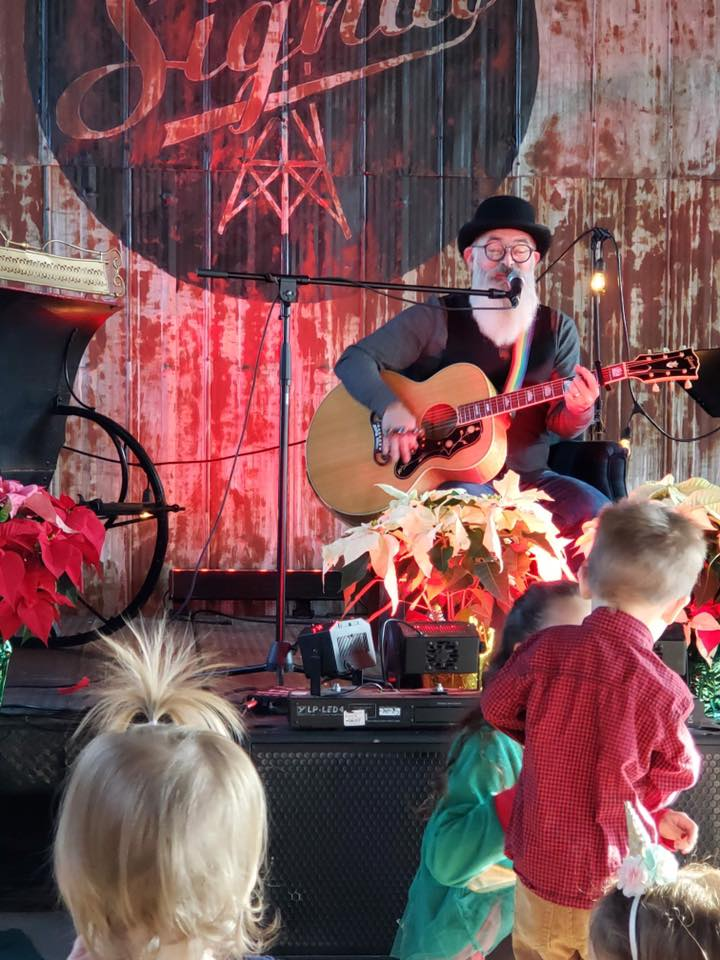 Singing on stage to little kids