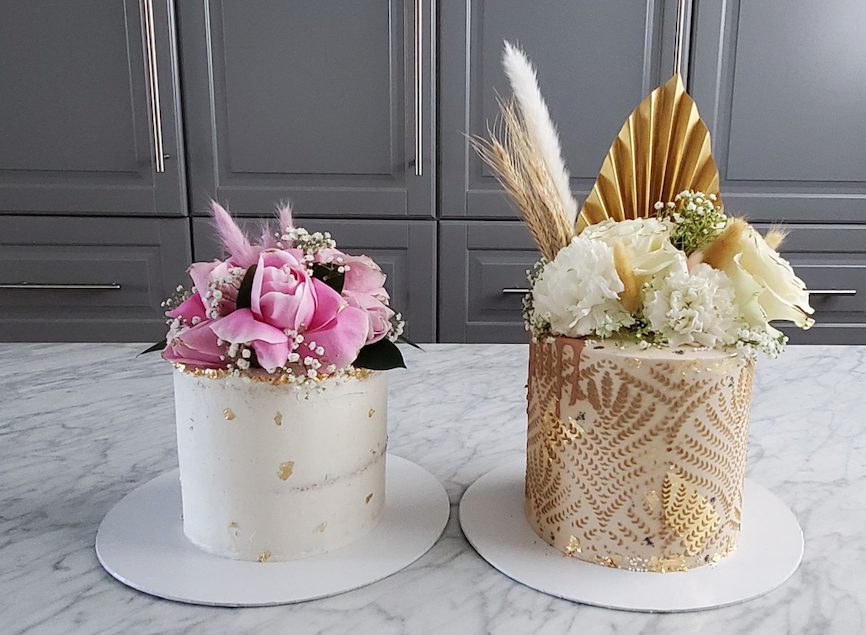 Two cakes on a marble counter.