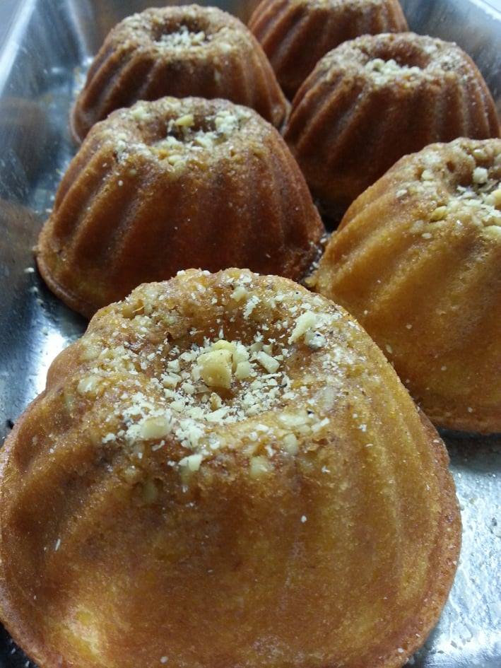 A row of small brown cakes.