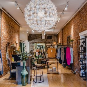 A clothing store with exposed brick walls.