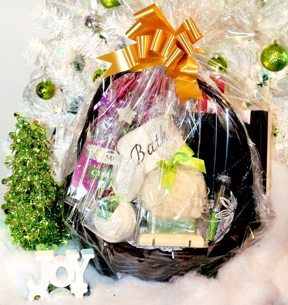 A gift basket filled with prizes on a white table.