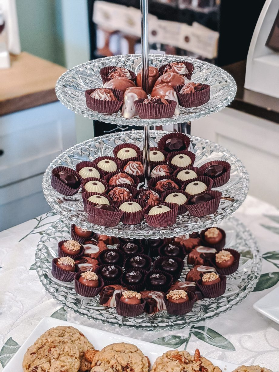 A tiered tray of various chocolates.
