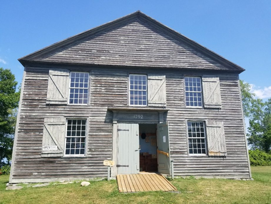 Old Hay Bay Church, a two-story building with clapboard siding, and a National Historic Site.