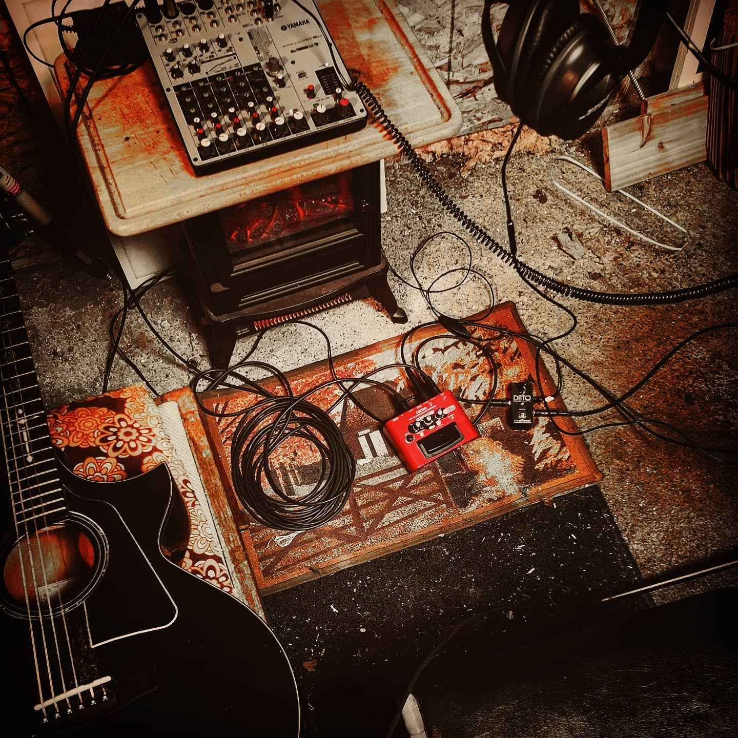 Guitar and sound set up on floor.